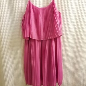 Pink pleated dress.